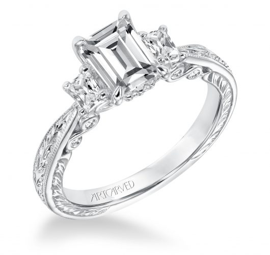 White gold emerald cut engagement ring with etch design