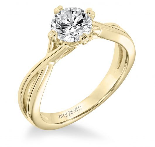 Yellow gold solitaire engagement ring with twist design