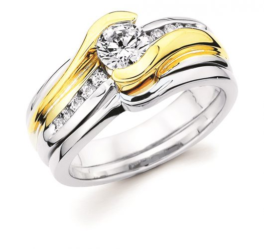 White & Yellow gold engagement ring with half bezel set round diamond
