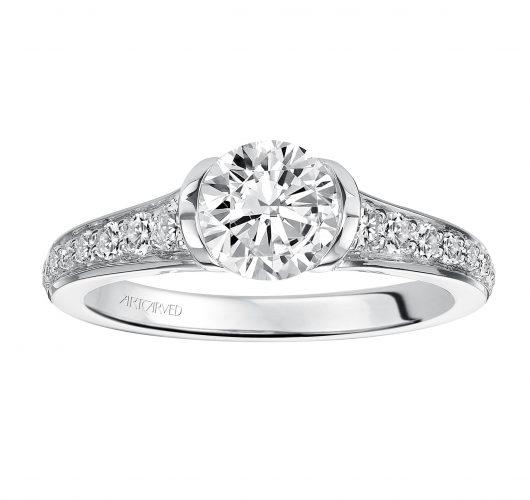 White gold engagement ring with half bezel set round diamond