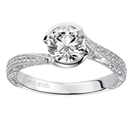 White gold bypass design engagement ring with half bezel set round diamond