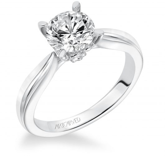 White gold tapered cathedral solitaire engagement ring