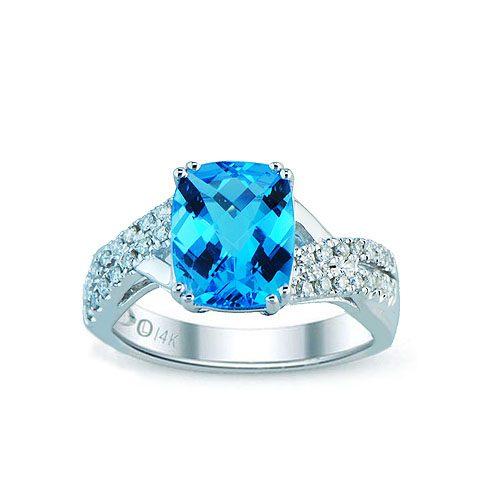 White gold swiss blue topaz & diamond ring
