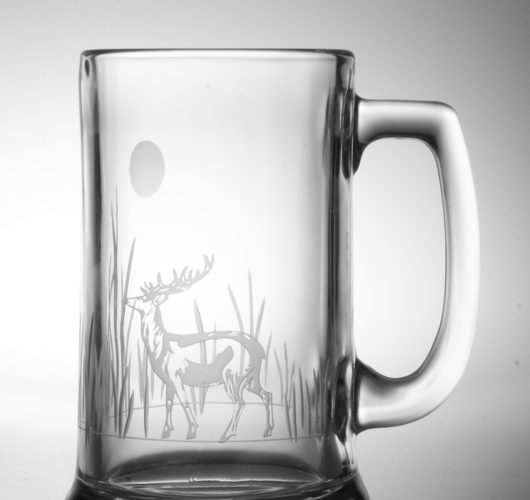Beer mug with etched deer design