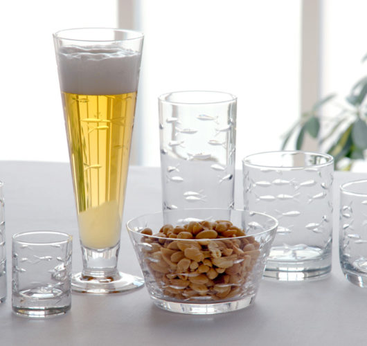 Glassware with etched school of fish design